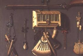 A Trompe l'Oeil Still life of a Gun, a Powder Horn, a Caged Bird and Hunting Equipment